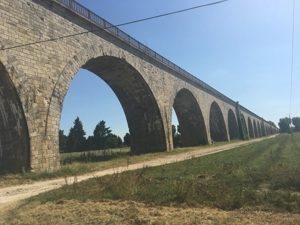 A really cool arch, that must be about 100 years old at least. Why not just make is solid? I am sure there is a very good reason. It leads to a bridge of sorts.