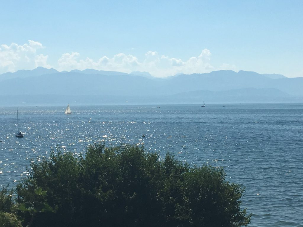 The lake with the mountains (Alps?) in the background. A bit hazy today.